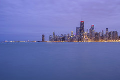Chicago from North Beach (Sam Wagner Photography) Tags: twilight lake michigan chicago illinois long exposure windy city cityscape skyline skyscrapers hancock tower navy pier winter blue hour smooth water magenta cloudy stormy gloomy
