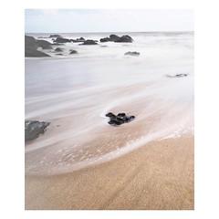Coastal Flow (Bron.Wolff) Tags: froth scenery nature landscape movement sand rocks pale white ocean beach seascape sea water flow