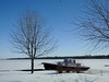 A boat grounded until spring on the shores of the Ottawa River in Gatineau, Quebec (Ullysses) Tags: boat bateau gatineau quebec canada winter hiver ice ottawariver rivièredesoutaouais