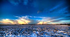 Clouds on the horizon. (Alex-de-Haas) Tags: 11mm aurorahdr d750 dutch hdr holland irix nederland nederlands netherlands nikon noordholland photomatix westfrisia westfriesland art artistic artistiek beautiful betoverend bevroren boerenland cloud clouds cold daglicht daylight desolate farmland fire flat frozen heaven hemel kou kunst landscape landschap licht light lucht mooi plat polder skies sky sneeuw snow sunrise verlaten vuur water winter wolk wolken wonderful zonsopgang