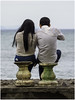 A young couple overlooks the sea. (Luc V. de Zeeuw) Tags: couple overlooking sea sitting kotadenpasar bali indonesia