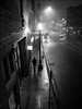 Foggy Evening (52607) (Kurt Kramer) Tags: blueline bucktownwalk chicago cityscape el monochrome northavenue sixcorners street urban wickerpark eerie mysterious blackandwhite bw reflections silhouette fog foggy wet wetpavement foreboding