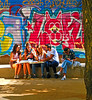 Having pizza for lunch (chrisk8800) Tags: graffitti lunch pizza youngpeople bench painting barcelona students