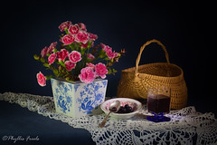 Still life with berries and juice. (Phyllis Freels) Tags: phyllisfreels basket blue blueberries bowl carnations flowers fruit glass indoor juice pink spoon stilllife tabletop vase white