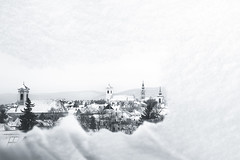 Through the snowy window (RobertFenyo) Tags: winter snow window city cityscape blackandwhite