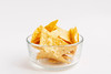 Close up of corn chips (wuestenigel) Tags: spice nachos unhealthy triangle crunchy fast nacho appetizer eat background snack fat mexico corn delicious spicy salty isolated mexican party fried white potato tasty taste meal fresh tortilla chips salt cuisine chip round crisp salsa hot yellow cheese food