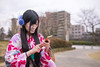 Young woman in kimono texting to friends in public park (Apricot Cafe) Tags: img26154 asia asianandindianethnicities higashichayamachi ishikawaprefecture japan japaneseethnicity japaneseculture kanazawa kimono sigma35mmf14dghsmart artscultureandentertainment charming chat cheerful citylife cultures day enjoyment fashion freedom freshness hairaccessory happiness lifestyles longhair oldfashioned oneperson onlywomen outdoors photography playing publicpark relaxation sitting smartphone smiling springtime straighthair texting toothysmile tourism tradition traditionalclothing tranquility travel traveldestinations waistup weekendactivities women youngadult