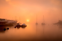 winters mist (Anthony White) Tags: christchurch england unitedkingdom gb dorset longexposure orangesunrise still naturaleza nature natur yachts reflection harbour bay club