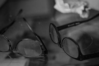crumpled facial tissue, eyeglasses, two pair, table top, reflections, Asheville, NC, Nikon D3300, mamiya sekor 80mm f-2.8, 3.1.18