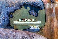 Patina (Paul Rioux) Tags: old vintage classic decay patina rust paint faded oxidation layers texture vehicle gmc generalmotors truck emblem chrome outdoor prioux insignia badge hood fender 9430