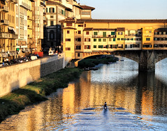 Rowing at the Ponte Vecchio in Florence, Italy (` Toshio ') Tags: toshio florence italy italian rowing bridge pontevecchio sunset water arnoriver river city travel europe european europeanunion canon canon7d building architecture