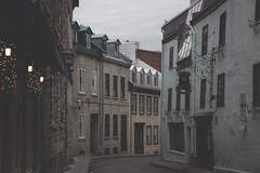 Old Quebec City Street - Film Imitation (Irrational Photography) Tags: street walk walking photography candid path people city shop shoppe window wall road architecture up ceiling look looking tilt light cloud glass rectangle support sky skylight symmetry building structure line outdoor quebec canada canon slr dslr t2i 550d kiss 5d mark iii digital photo picture lens retro vintage antique hipster old analogue analog film grain noise couillard rue pub patrick st restaurant bar stone irrational