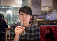 Young woman drinking at night (Apricot Cafe) Tags: img24185 asia asianandindianethnicities cafe japan japaneseethnicity kyobashitokyo sigma35mmf14dghsmart tokyojapan beer buildingexterior capitalcities casualclothing charming cheerful citylife consumerism dating dinner drinking enjoyment fancy fashion foodanddrink foodanddrinks freedom friendship glass happiness indoors lifestyles night oneperson onlywomen photography restaurant retail satisfied shopping sitting smiling springtime street success togetherness waistup weekendactivities women youngadult chūōku tōkyōto jp