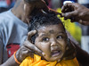 Child Devotee gets her head shave_Thaipusam_DSC_8874 (PRADEEP RAJA K- https://www.pradeeprajaphotos.com/) Tags: thaipusam malaysia people religion indian festival asia hindu culture god hinduism lord religious worship kuala celebration spirituality devotee faith temple shrine body traditional prayer event pain pilgrimage pierced ethnicity tamil piercing holy cave tourism india batu spiritual kavadi lumpur devotion praying walking sacrifice orange annual bright incense travel coconut ritual tourist caves devote celebrate gold ceremony limestone malaysian pierce hook spirit tradition faithful belief woman male sacred red muruga trance devotees closeup street crowd cultural