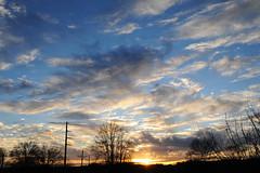 don't let it get away (javan123) Tags: sunset silhouette sun sky tamron nikon suburbia d700 clouds blue hometown