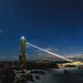 A lighthouse under the starry sky