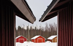 Back row (STTH64) Tags: wooden winter barn boat boathouse red snow white ice alley symmetric