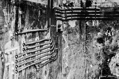 Crossing Pipes (20/31) (meepeachii) Tags: lost lostplace lostplaces places forgotten abandoned weathered burned old foundry abandonedplace pipes blackandwhite bw monochrome structure wall room bavaria germany bayreuth fire industry decline photography nikon