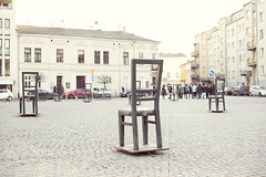 Plac Bohaterow Getta, Krakow, Poland (Cat Girl 007) Tags: placbohaterowgetta ghettoheroessquare krakow poland memorial podgórzedistrict ghetto square chair monument architecture statue sculpture historical nazism history holocaust getta europe jews jewishwarmemorial ww2 remembrance city metal jewish culture furniture death empty editorial