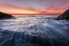Rush (Pavel Pronin) Tags: bulgaria blacksea seascape sunrise sea ocean outdoorphotography ravda nessebar water colors colours bright sun rocks wet wave rush cold warm sunnybeach january cliffs shore europe eurpoeanunion balkans balkanpeninsula dawn cape bay beach sand
