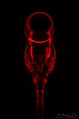 Keeper of the Flame (Neferkheperure) Tags: glass red sculpture light lightpainting dark ball glassball