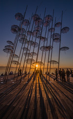 The umbrellas at sunset (Vagelis Pikoulas) Tags: macedonia thessaloniki salonica greece north balkans travel photography umbrella umbrellas sun sunset sunburst silhuette people shadow shadows colors colour tokina 1628mm canon 6d february winter 2018 view