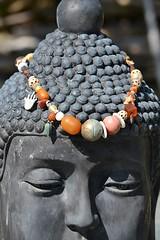 Adorned Buddha on Valentine's (jungle mama) Tags: buddha necklace hair sculpture livinginajungle bead siddharthagautama siddhartha gautama