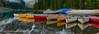 Moraine Lake Canoes (RichHaig) Tags: banffnationalpark water snow landscape canoes nikonnikkor1424mmf28 gitzotripod nationalpark mountains alberta canada richhaig nikond800 morainelake clouds anationalpark