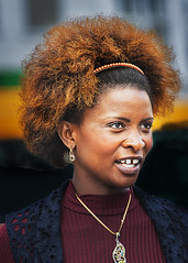 Portrait (D80_407011) (Itzick) Tags: copenhagen denmark candid color colorportrait youngwoman face facialexpression portrait d800 itzick earrings necklace headgear blackwoman