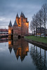 Still Standing (McQuaide Photography) Tags: haarlem noordholland northholland netherlands nederland holland dutch europe sony a7riii ilce7rm3 7rm3 alpha mirrorless 1635mm sonyzeiss zeiss variotessar fullframe mcquaidephotography lightroom adobe photoshop tripod manfrotto bluehour stad city urban lowlight architecture outdoor outside illuminated building longexposure oldbuilding old oud character traditional authentic winter nopeople citygate gatehouse amsterdamsepoort 1355 14thcentury middleages medieval history historic geschiedenis rijksmonument nationalmonument portrait bulbmode ndfilter neutraldensity nd bwfilters water reflection
