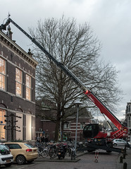 Excitement at School (natures-pencil) Tags: school people crowd parking suburban crane vehuicles event street bollenhofsestraat utrecht nederland netherlands building
