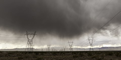 0246937600-96-High Power Lines on Stormy Mojave Desert-2 (Jim There's things half in shadow and in light) Tags: america canon5dmarkiv eldoradocanyon macrophotography mojavedesert nevada places southwest tamronsp1530mmf28divcusd tamronsp90mmf28dimacro11vcusd usa clouds cloudy desert landscape powerlines rain stormy