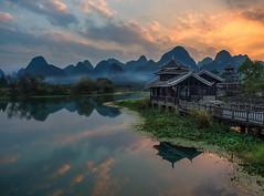 Shangri-la (v-_-v) Tags: china yangshuo guilin li river asia sunset house mountains limestone water sky clouds shangrila