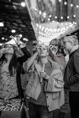 Peeking Through (SemiXposed) Tags: market queen victoria night melbourne sony australia girls slides photos bokeh jackets candid lights city black white cold summer