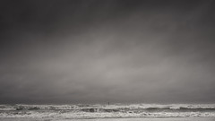 Rough sea (voxpepoli) Tags: sky sea waves roughsea storm clouds rain grey landscape beach emptiness scary darkness