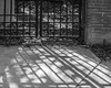 L2000981 (agianelo) Tags: metal bar gate bw blackandwhite shadow sidewalk