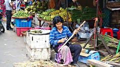 Shaving Bamboo (CAMBODIA) (ID Hearn Mackinnon) Tags: cambodia cambodian south east asia asian 2017 bamboo shaving fruit vegetables market street worker lady woman people working culture society city urban