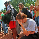 A student prays during a Brickyard vigil on 9/11.