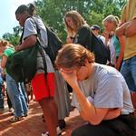 A student prays during a Brickyard vigil on 9/11.