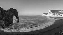 West Lulworth   |   Durdle Door Panorama (JB_1984) Tags: durdledoor durdledor arch limestonearch limestone geologicalformation geology cliff sea coast coastline beach panorama blackandwhite bw mono englishchannel purbeckheritagecoast jurassiccoast unesco worldheritagesite westlulworth purbeckdistrict dorset england uk unitedkingdom nikon d500 nikond500 explore explored