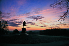 Daybreak (Jen_Vee) Tags: sunrise sun sky blue pink statues wayne history monuments valleyforge park silhouette seasons winter morning trees grass tree branches