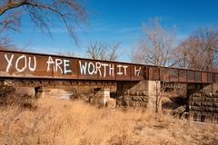 positive affirmation (backbeatb00gie) Tags: graffiti leica brick bridge concrete industrial myworld outside positive traintrack winter