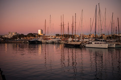 Evening light...... (Dafydd Penguin) Tags: evening light sun sunset dusk twilight water reflections orange port harbour harbor dock quay moorings yacht yachting sailboat boat harbourside waterside sea seaside barcelona vell catalunya catalonia spain leica m10 summicron 35mm f2 asph