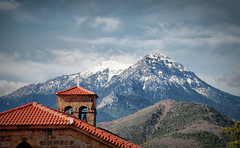 In the peloponesian mountains (jimiliop) Tags: mountains church cross mountaintops peloponese greece feneos goura roof snow bells village architecture stone sky clouds dramatic telescope
