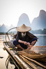 Cormorant Fisherman in Guilin (mlhell) Tags: china cormorantfishermen guilin karstmountains landscape lijangriver mountains nature portrait river rural xingping