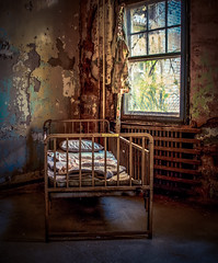 Room With a View (Thomas James Caldwell) Tags: pennsylvania state institution for feebleminded school hospital eastern epileptic pennhurst mayflower building bed abandoned america abandonedamerica neglected decayed window curtain light sunlight shadow decay awful