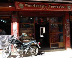 Storefront, motorcycle parked in front, Woodmandu Furniture, Coca-cola signs, smiling local man, Bodha, Kathmandu, Nepal (Wonderlane) Tags: woodmandu furniture woodmandufurniture nepal kathmandu wonderlane 1863 motorcycleparkedinfrontofthewoodmandufurniturestorefront cocacolasigns bodha motorcycle parked front storefront playonwordsamotorcycleparkedinfrontofthewoodmandufurniturestorefront playonwords play words lettering wood