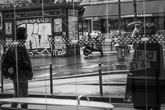 Bus Station (Nicola Gilg) Tags: street streetphotography strasse schwarzweiss shadow bus people paris person photography passing outdoor documentation canon 50mm