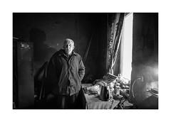 Cemetery watchman (Paphylo) Tags: leicaq lvov ukraine city portrait people reallife blackandwhite contrast lviv monochrome indoor document cemetery watchman