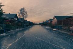 Ice (stefanfortuin) Tags: ice skating blue yellow orange houses nederland netherlands ijs schaatsen dutch friesland wolvega stellingwerf huis bomen boom crack scheur blauw canon 500d 10mm